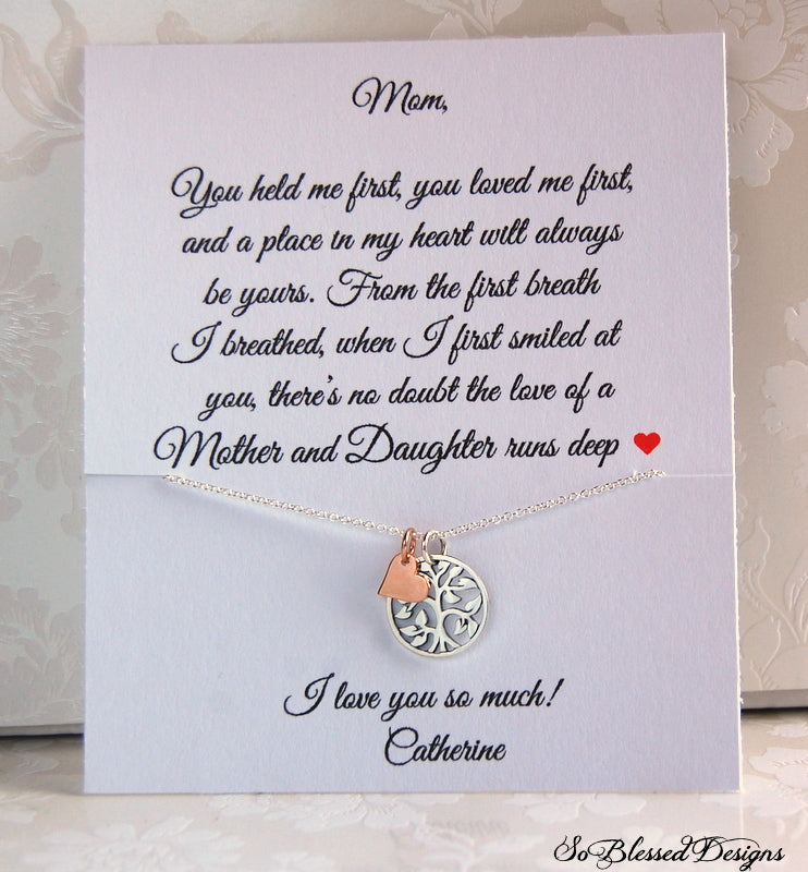 Sterling silver and rose gold family tree necklace displayed on jewelry message card
