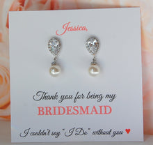 Pearl drop bridesmaid earrings displayed on personalized thank you for being my bridesmaid card