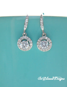 Pair of silver round solitaire earrings