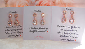 Sets of rose gold earrings with personalized bridesmaid cards