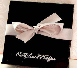 Black So Blessed Designs gift box with ribbon bow