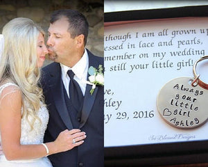 Dad kissing daugther on nose after giving him always your little girl keychain