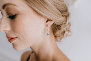 Victorian style bridal earrings on bride