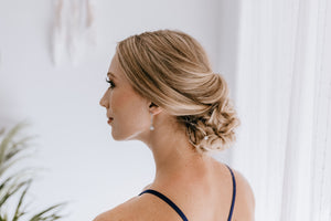 Bridesmaid turning head to side showing long bridesmaid earrings