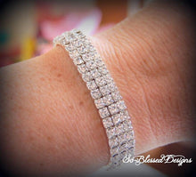Lady wearing silver cubic zirconia bracelet for bridesmaids