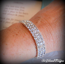 Bridesmaid wearing 3 row silver cz bracelet