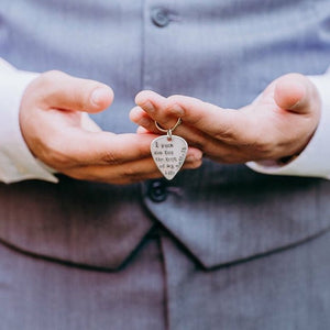 Groom holding I pick you keychain from his bride
