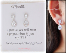 Maid of Honor wearing silver teardrop earrings