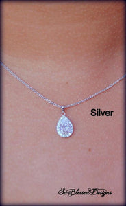 Silver teardrop necklace worn by mother of the bride
