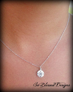 bridesmaid wearing silver compass pendant necklace