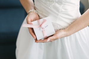 Bride gifting earrings to bridesmaids