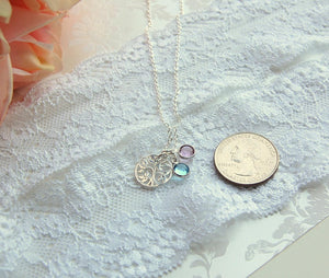 mother of groom necklace next to quarter for size reference
