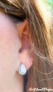 Close up of silver teardrop earrings for mother of bride