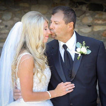 Dad giving daughter a butterfly kiss on the nose on her wedding day
