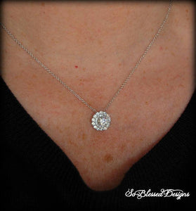 Mother of the Groom wearing beautiful solitaire necklace at sons wedding