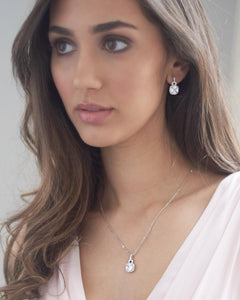 Gorgeous bridesmaid wearing square CZ earrings and necklace set