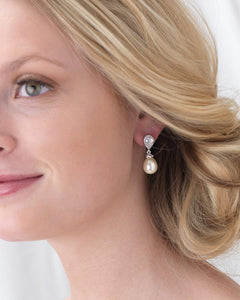 Bride wearing pearl drop and crystal earrings