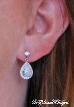 bridesmaid wearing cubic zirconia drop earrings