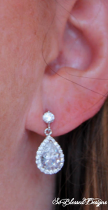 Maid of Honor wearing silver teardrop wedding earrings