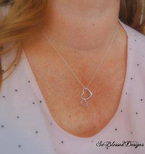 Mother of the bride wearing hearts necklace on daughters wedding day