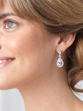 Bride wearing stunning bridal earrings on wedding day