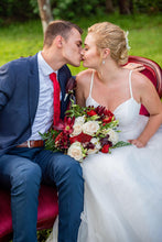 bride kissing groom during wedding