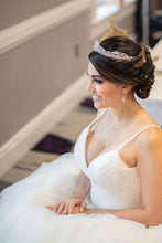 Bride posing with her new stunning bridal earrings