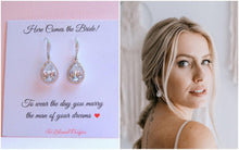 Bride wearing crystal teardrop earrings on wedding day