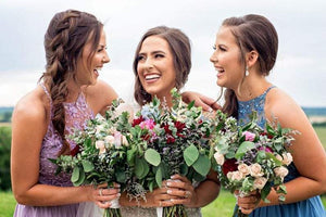 Bride and bridesmaids wearing matching teardrop earrings for wedding