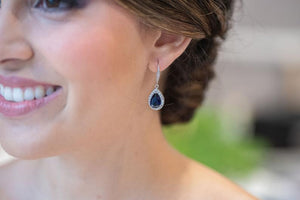bridesmaid wearing navy blue earrings