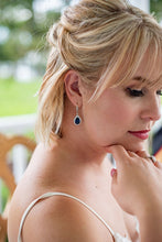 Bride wearing navy blue earrings as something blue on wedding day