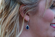 bridesmaid with silver and navy blue earrings on