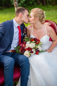 Groom kissing bride on wedding day
