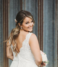 bride wearing silver teardrop earrings on wedding day