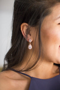 mother of the groom showing her rose gold wedding earrings