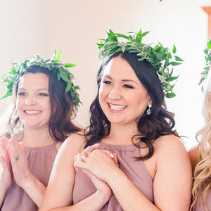 bridesmaids wearing silver teardrop earrings at wedding