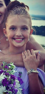junior bridesmaid wearing teardrop earrings