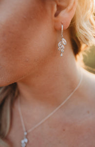 Bridesmaid wearing silver leaf earrings and necklace set