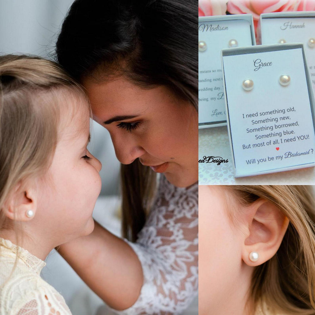 Flower girl wearing pearl earrings with bride