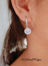 bridesmaid wearing CZ solitaire earrings