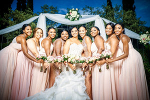 Bride with bridesmaids wearing rose gold wedding earrings