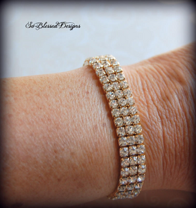 Mother of Groom wearing gold cz bracelet
