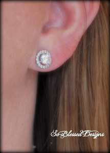 bridesmaid wearing silver solitaire earrings on wedding day