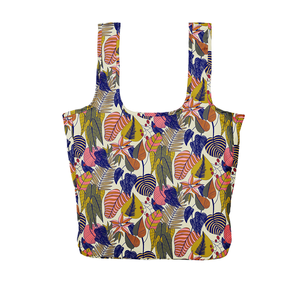 A large botanical patterned reusable tote with yellow, pink, blue and green leaves.