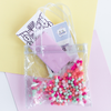 Cute tiny bag in clear vinyl with colorful pom poms