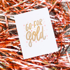 White greeting card with gold text