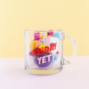 Is it Friday Yet? Glass Mug is a funny coffee mug in pinks and red filled with colorful pom poms