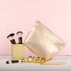 Tweedle Dum Metallic is a cute cosmetics bag with a zippered top.