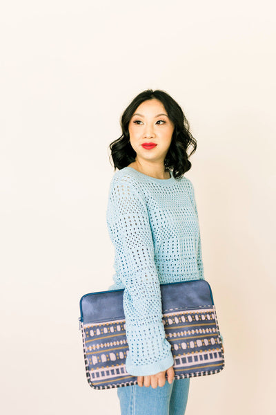 Girl in a blue sweater holding a cute laptop case in Boho Dress pattern.