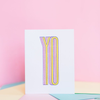 White greeting card with vertically stretched text